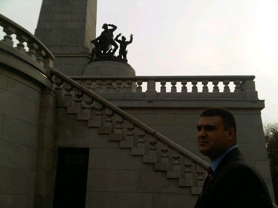 Rep. Mike Unes R-East Peoria by the soldier statue on the terrace of Lincoln's tomb; the soldier in the middle is still holding the handle in his left hand, though the blade of the sword is gone