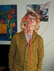 18-yr-old artist Quinn Koeneman of Urbana models a piece of wearable sculpture he created while at art school