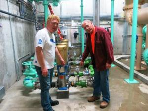 Staunton, Ill., Mayor Craig Neuhaus (left) checks out the town's new water plant with Hank Fey, a public works director. (Bill Wheelhouse/ Harvest Public Media)
