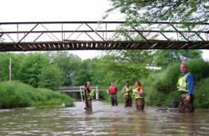 One of the U.S. Geological Survey teams collecting water samples and checking cages for fish eggs in Missouri this summer: biologist Diana Papoulias, chemist Dave Alvarez, hydrologist Peter Van Metre, biologist Diane Nicks and environmental toxicologist Don Tillitt (Abbie Fentriss Swanson/Harvest Public Media)