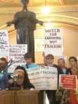 While some environmental groups signed on to the compromise law, others - like these activists protesting at the Capitol - remain opposed to anything but a moratorium on fracking.